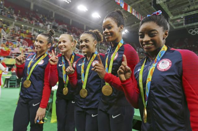 2016 Rio Olympics - Artistic Gymnastics - Final - Women's Team Final - Rio Olympic Arena - Rio de Janeiro, Brazil - 09/08/2016. (L-R) Alexandra Raisman (USA) of USA (Aly Raisman), Madison Kocian (USA) of USA, Laurie Hernandez (USA) of USA, Gabrielle Douglas (USA) of USA (Gabby Douglas) and Simone Biles (USA) of USA with their gold medals after winning the women's team final. REUTERS/Mike Blake FOR EDITORIAL USE ONLY. NOT FOR SALE FOR MARKETING OR ADVERTISING CAMPAIGNS.