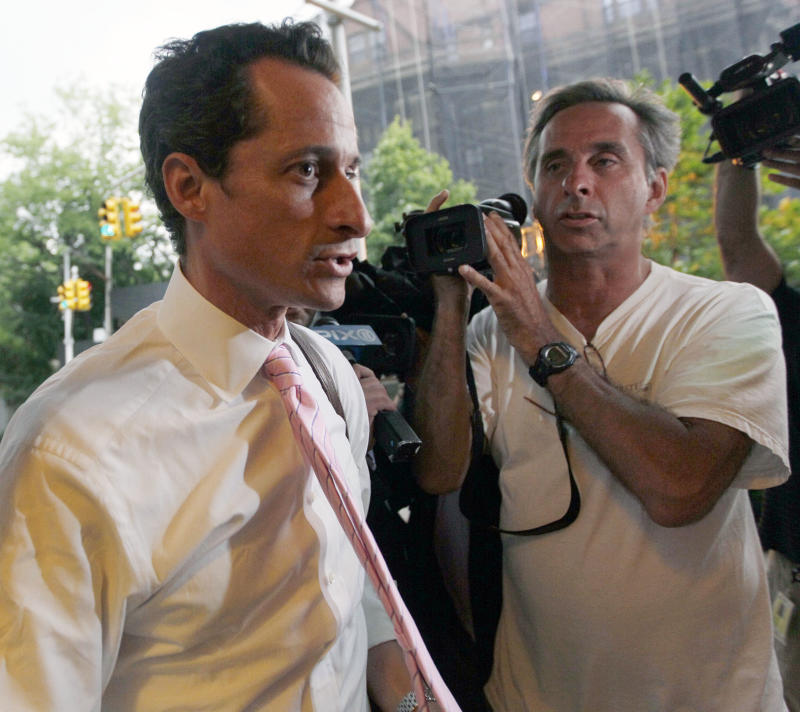 Rep. Anthony Weiner, D-N.Y., is surrounded by reporters as he arrives at his house in the Queens borough of New York,  Thursday, June 9, 2011. Weiner admitted four days ago that he had Tweeted sexually charged messages and photos to at least six women and lied about it.  (AP Photo/Mary Altaffer)