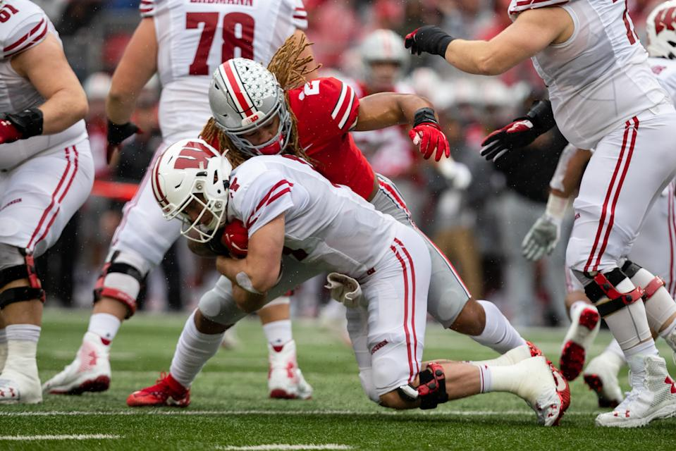Ohio State's Chase Young takes down Wisconsin QB Jack Coan for one of his four sacks on Saturday. (Getty)