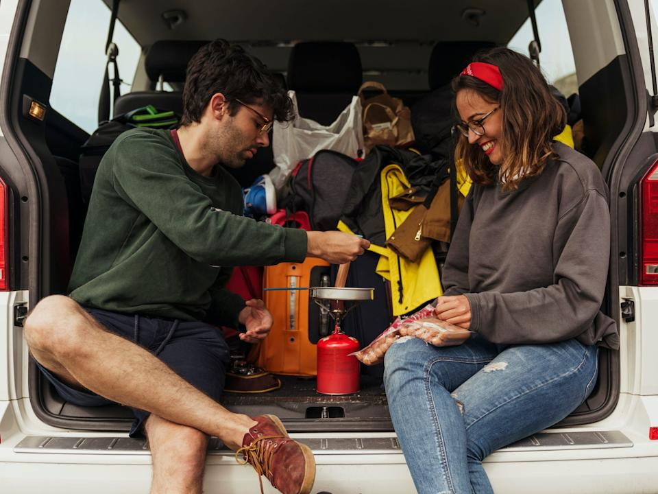 couple tailgate camping