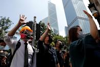 FILE PHOTO: Anti-government office workers wearing masks attend a lunch time protest, after local media reported on an expected ban on face masks under emergency law, at Central, in Hong Kong
