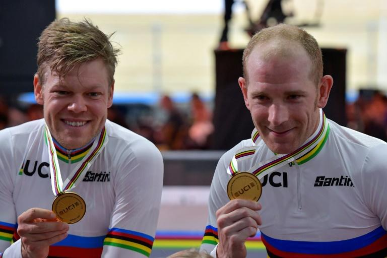 Denmark's Michael Morkov (R) and Lasse Norman Hansen celebrate winning the madison world title a day after Morkov was released from quarantine