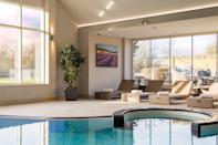 """<p>Prettily nestled in 65 acres of glorious grounds on the banks of the River Windrush, this honey-hued stone luxury spa hotel has a gorgeous wellness space in the heart of its landscaped gardens.</p><p>Pamper, preen and polish with an ESPA treatment in one of the three suites, and enjoy a dip in the inviting pool. Outside the spa, there's also a croquet lawn and tennis court to keep you busy, as well as wood-beamed restaurant serving up modern British cuisine.</p><p>Wander around the charming nearby Cotswolds village of Minster Mill, or head into Oxford for some historic culture. Blenheim Palace is also on the doorstep for a step back in time.</p><p><strong>Covid-19 update</strong>: There is a reduced treatment menu and facilities are subject to capacity limits.<strong><br><br>Red readers can save up to 25% on two nights in a Superior Room with a three-course dinner and breakfast included.</strong></p><p><a class=""""link rapid-noclick-resp"""" href=""""https://www.redescapes.com/offers/cotswolds-minster-lovell-minster-mill-hotel"""" rel=""""nofollow noopener"""" target=""""_blank"""" data-ylk=""""slk:CHECK AVAILABILITY"""">CHECK AVAILABILITY</a><br></p>"""