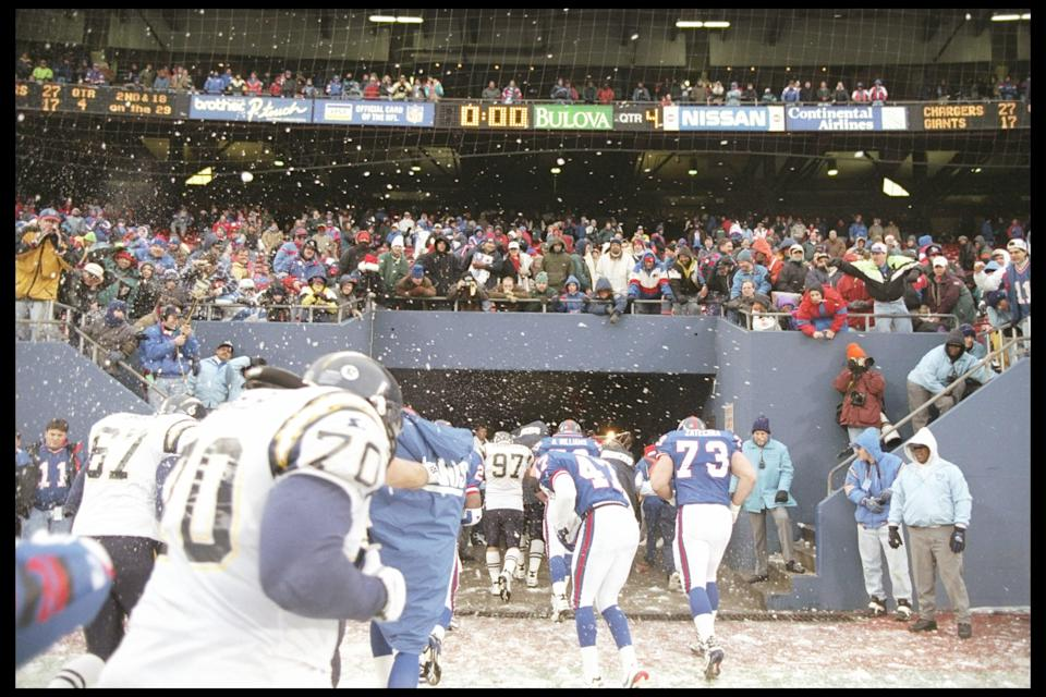 Players on both the New York Giants and the San Diego Chargers try to avoid snowball thrown by fans at Giants Stadium in 1995. (AP)