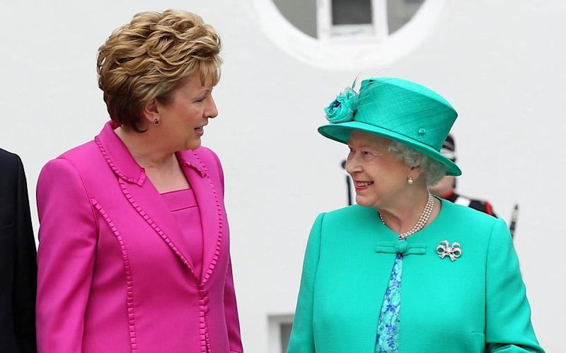 Mary McAleese talks to the Queen during her historic four-day visit to Ireland in 2011 - Peter Muhly/AFP