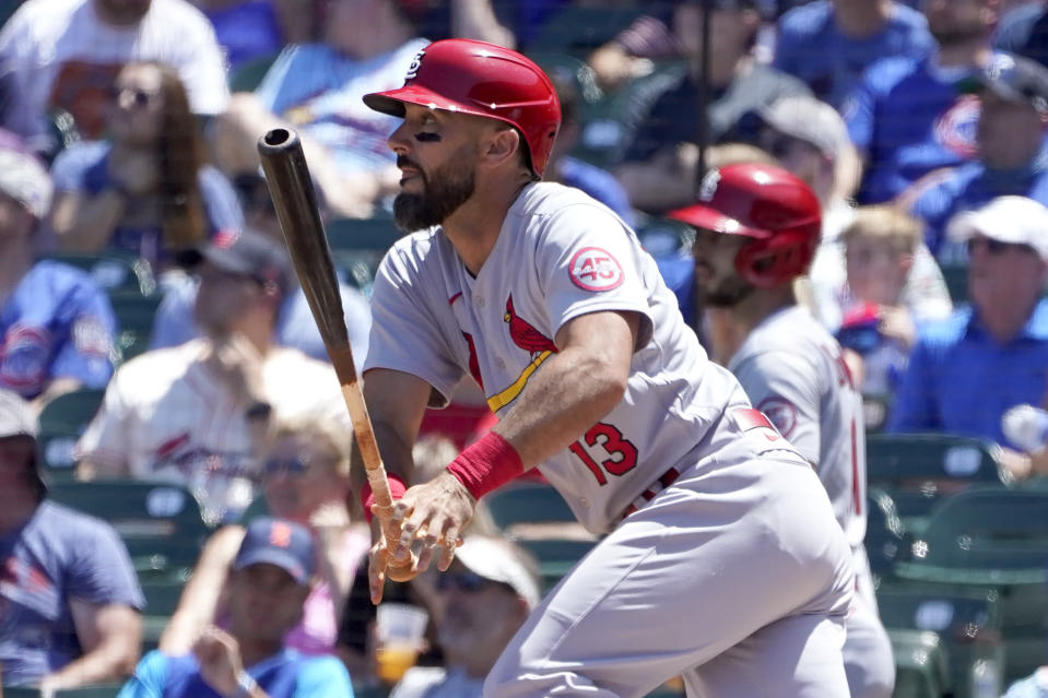 St. Louis Cardinals' Matt Carpenter watches his RBI single off Chicago Cubs starting pitcher Kohl Stewart during the second inning of a baseball game Friday, June 11, 2021, in Chicago. (AP Photo/Charles Rex Arbogast)