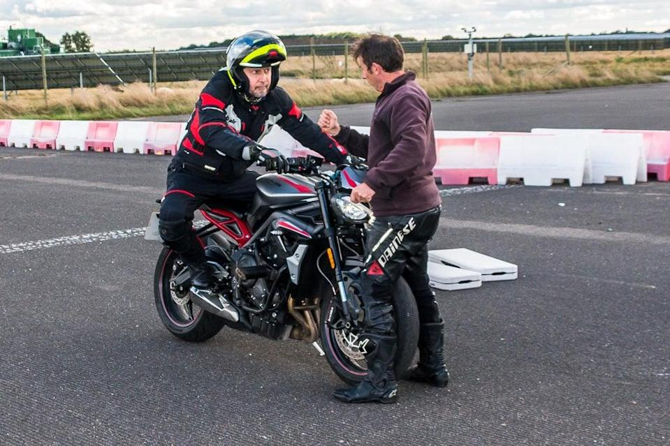 Leaning in: David Williams receives instruction from motorcycle coach Tom Killeen (David Williams)