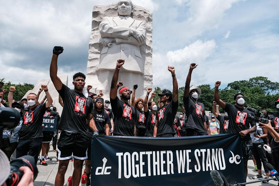 Members of the Washington Wizards and Washington Mystics basketball teams rally at the MLK Memorial to support Black Lives Matter and to mark the liberation of slavery on June 19, 2020 in Washington, DC (Getty Images)