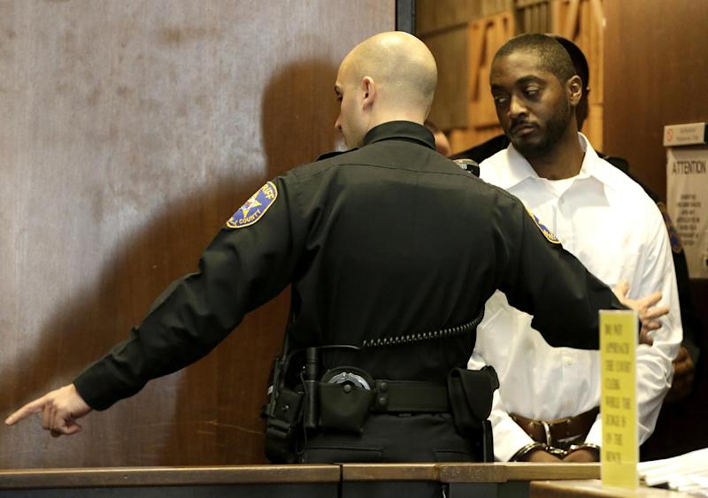 Basim Henry, 32, right, one of four accused in the Dec. 15, 2013, carjacking at The Mall at Short Hills, where Dustin Friedland, of Hoboken, was fatally shot as he returned with his wife to their vehicle, walks into the courtroom for an arraignment hearing at Essex County Superior Court, Wednesday, Jan. 8, 2014, in Newark, N.J. Hanif Thompson, 29, Karif Ford, 31, and Kevin Roberts, 33, were also charged during the morning arraignment. All four pleaded not guilty. Each has been charged with murder, felony murder, carjacking, conspiracy, possession of a weapon and possession of a weapon for unlawful purpose. (AP Photo/Julio Cortez)