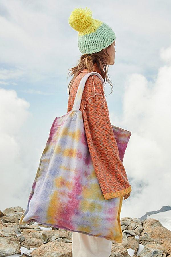 """<p>This <a href=""""https://www.popsugar.com/buy/Ashbury-Tie-Dye-Tote-514355?p_name=Ashbury%20Tie-Dye%20Tote&retailer=freepeople.com&pid=514355&price=58&evar1=savvy%3Aus&evar9=47208848&evar98=https%3A%2F%2Fwww.popsugar.com%2Fphoto-gallery%2F47208848%2Fimage%2F47208856%2FAshbury-Tie-Dye-Tote&list1=shopping%2Ceco-friendly%2Csustainability&prop13=api&pdata=1"""" rel=""""nofollow"""" data-shoppable-link=""""1"""" target=""""_blank"""" class=""""ga-track"""" data-ga-category=""""Related"""" data-ga-label=""""https://www.freepeople.com/shop/ashbury-tie-dye-tote/?category=SEARCHRESULTS&amp;color=095"""" data-ga-action=""""In-Line Links"""">Ashbury Tie-Dye Tote</a> ($58) can hold just about everything.</p>"""
