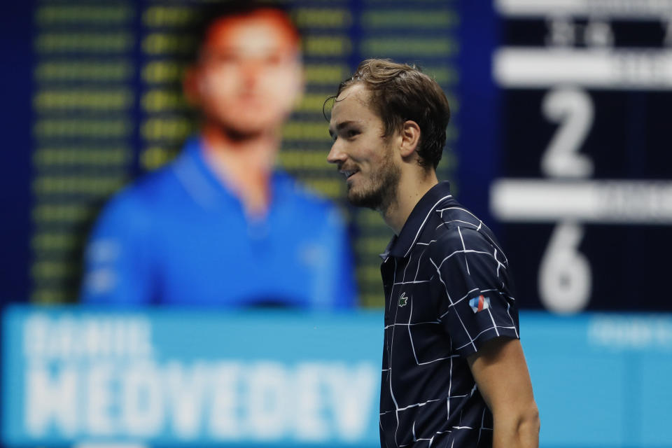 Daniil Medvedev of Russia smiles after winning against Rafael Nadal of Spain in their semifinal match at the ATP World Finals tennis tournament at the O2 arena in London, Saturday, Nov. 21, 2020. (AP Photo/Frank Augstein)