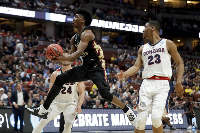 <p>Florida State guard Terance Mann, drives to the basket past Gonzaga guard Zach Norvell Jr., left, and forward Corey Kispert during the first half an NCAA men's college basketball tournament West Region semifinal Thursday, March 28, 2019, in Anaheim, Calif. (AP Photo/Marcio Jose Sanchez) </p>