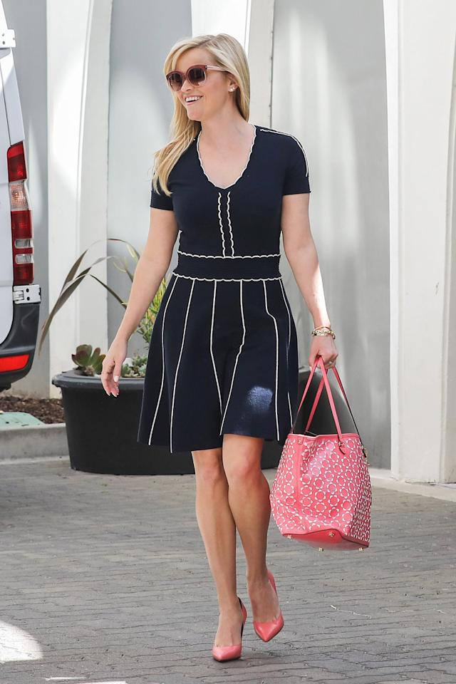 Witherspoon in a Draper James blue dress with white piping. (Photo: AKM-GSI)