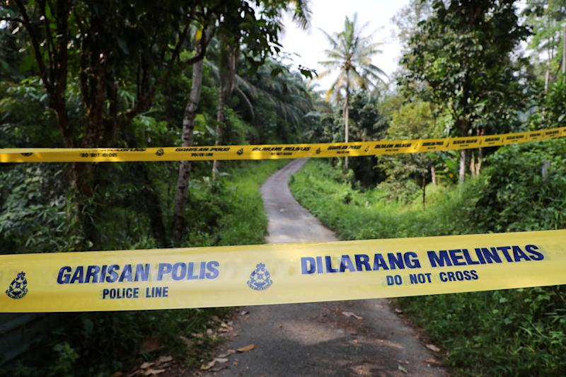A police line is seen at an entrance to the Dusun Resort, where 15-year-old Irish girl Nora Anne Quoirin went missing in Seremban, Malaysia, August 13, 2019. REUTERS/Lim Huey Teng