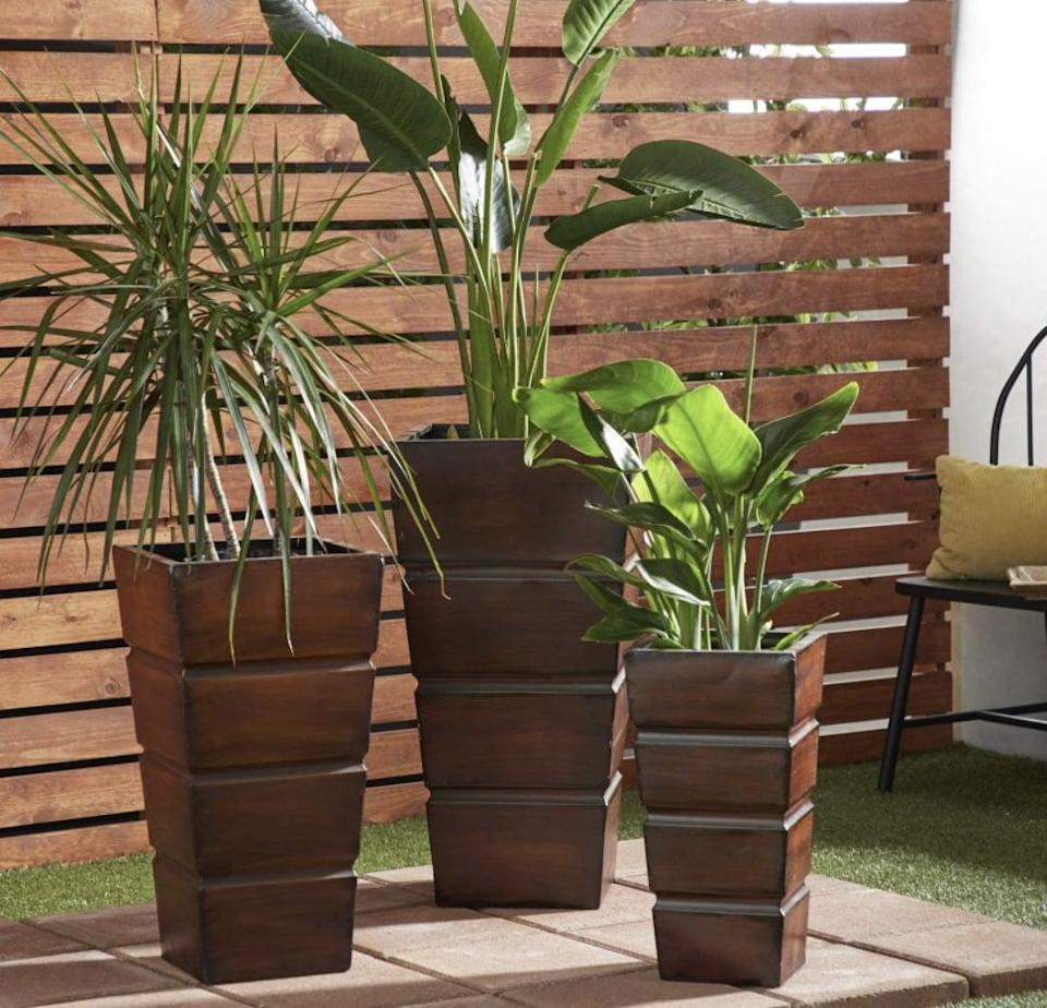 <p>These <span>Deco 79 Metal Planters</span> ($164 each) will blend nicely with their environment.</p>