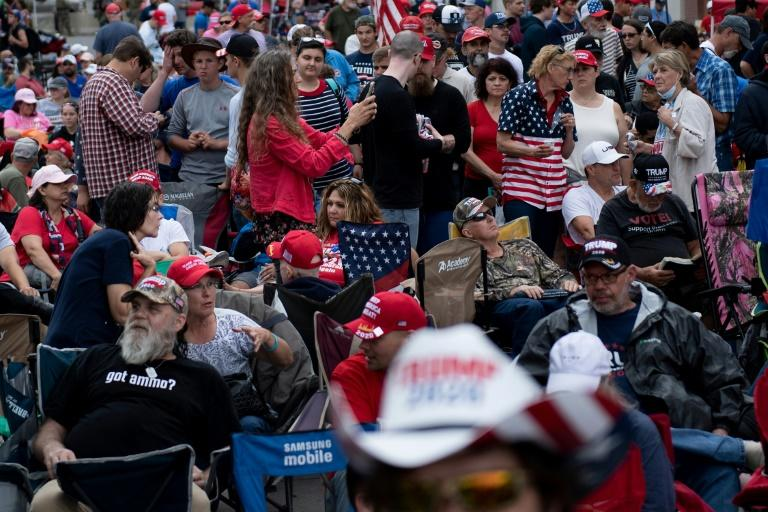 Few of the people waiting to attend the Trump rally in Tulsa, Oklahoma on June 20, 2020 wore masks or took precautions against the coronavirus (AFP Photo/Brendan Smialowski)