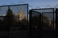 A section of fencing with razor wire blocking the Capitol grounds, Monday, March 1, 2021, is seen in Washington. (AP Photo/Jacquelyn Martin)