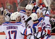 New York Rangers' Brian Boyle, centre, celebrates a goal during the third period of game three of first round NHL Stanley Cup playoff hockey action at the Scotiabank Place in Ottawa on Monday, April 16, 2012. (AP Photo/The Canadian Press, Sean Kilpatrick)