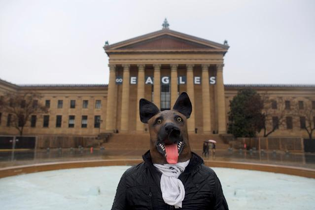 A person wears an underdog mask outside the Philadelphia Art Museum, before the Super Bowl LII game between the Philadelphia Eagles and New England Patriots, in Philadelphia, Pennsylvania U.S. February 4, 2018. REUTERS/Mark Makela
