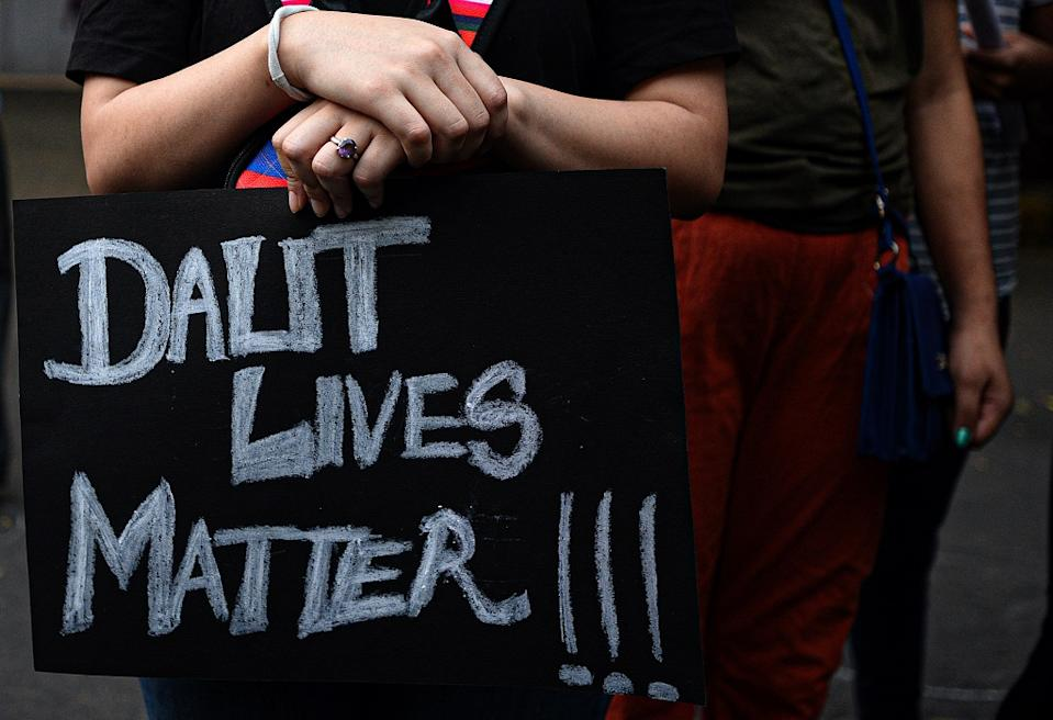 "A demonstrator with a placard that reads ""Dalit Lives Matter"" in a protest against the Hathras incident at Jantar Mantar, on October 4, 2020 in New Delhi, India.  (Photo by Biplov Bhuyan/Hindustan Times via Getty Images)"