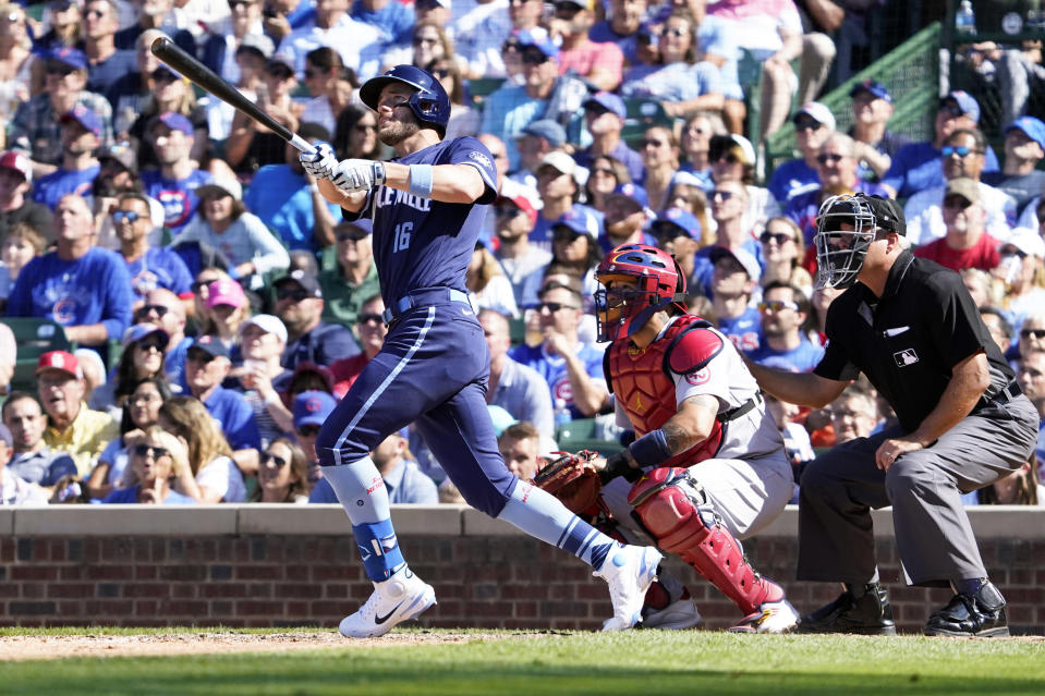 Chicago Cubs' Patrick Wisdom (16) hits a two-run home run against the St. Louis Cardinals during the seventh inning of a baseball game, Friday, July 9, 2021, in Chicago. (AP Photo/David Banks)
