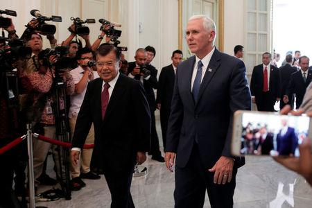 U.S. Vice President Mike Pence (R) walks with Indonesia's Vice President Jusuf Kalla at the Vice President office in Jakarta, Indonesia April 20, 2017. REUTERS/Beawiharta
