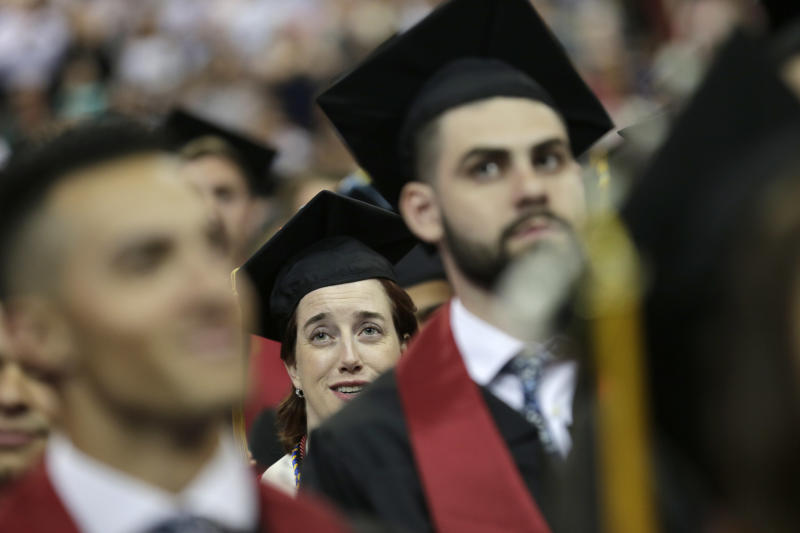 New graduates participate in an undergraduate commencement ceremony for Ramapo College in Newark, N.J., Thursday, May 10, 2018. (AP Photo/Seth Wenig)