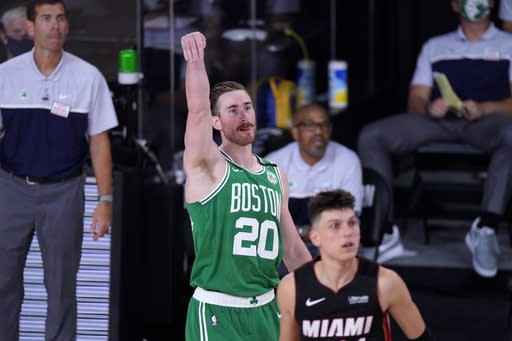 Boston Celtics' Gordon Hayward (20), Miami Heat's Tyler Herro, right front, and head coach Brad Stevens, left rear, all watch a shot attempt by Hayward during the second half of an NBA conference final playoff basketball game, Saturday, Sept. 19, 2020, in Lake Buena Vista, Fla. (AP Photo/Mark J. Terrill)