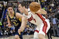 Miami Heat guard Goran Dragic (7) drives in front of Indiana Pacers guard T.J. McConnell (9) during the first half of an NBA basketball game in Indianapolis, Wednesday, Jan. 8, 2020. (AP Photo/AJ Mast)