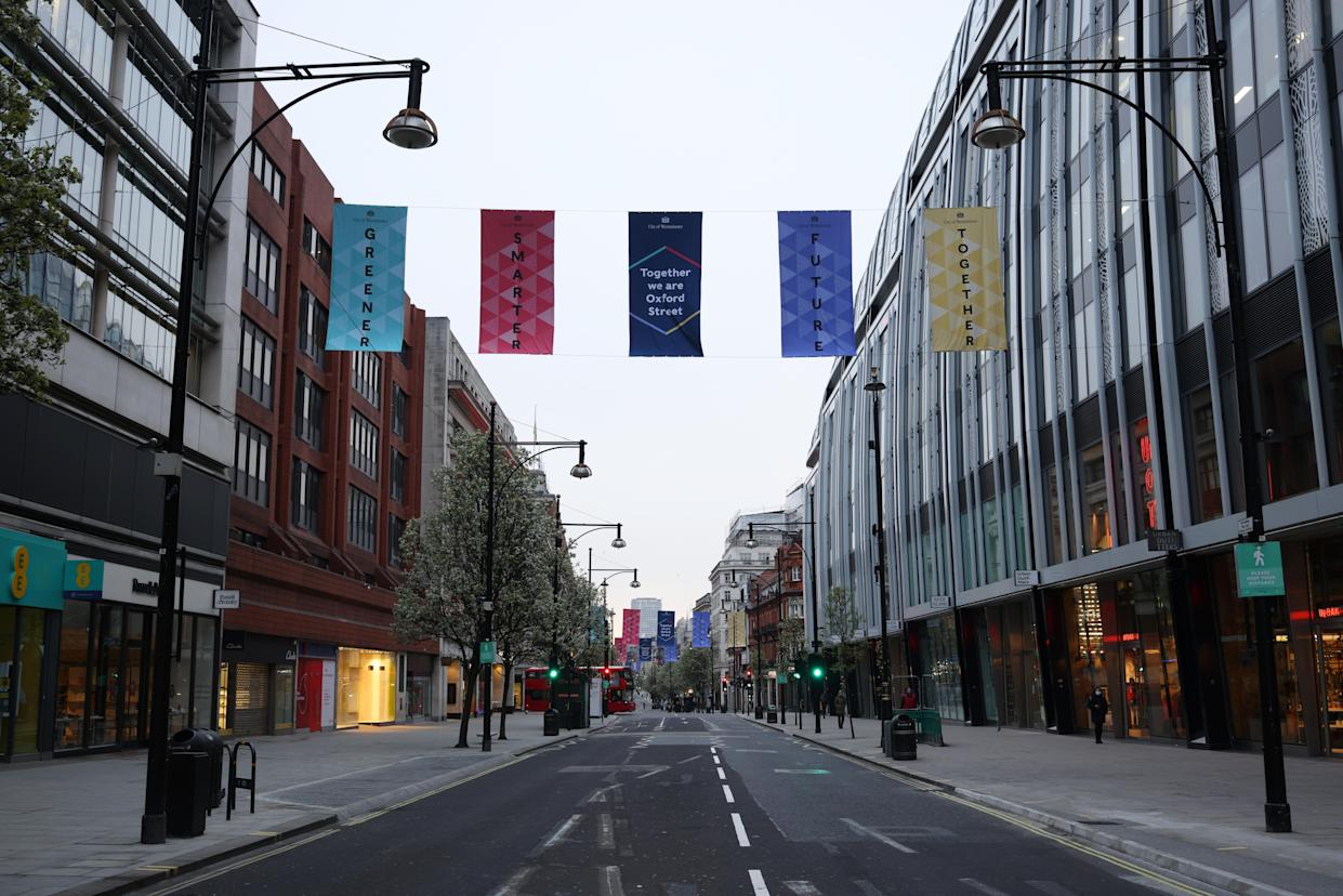 LONDON, ENGLAND - APRIL 12: A general view of a quiet Oxford Street before the shops reopen today as coronavirus restrictions ease on April 12, 2021 in London, United Kingdom. England has taken a significant step in easing its lockdown restrictions, with non-essential retail, beauty services, gyms and outdoor entertainment venues among the businesses given the green light to re-open with coronavirus precautions in place. Pubs and restaurants are also allowed open their outdoor areas, with no requirements for patrons to order food when buying alcoholic drinks.  (Photo by Dan Kitwood/Getty Images)