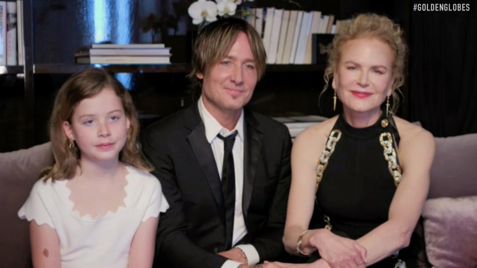 Pictured in this screengrab (l-r) Faith Margaret Kidman-Urban, Keith Urban and Nicole Kidman speak from their home via video call during the 78th Annual Golden Globe Awards broadcast on February 28, 2021