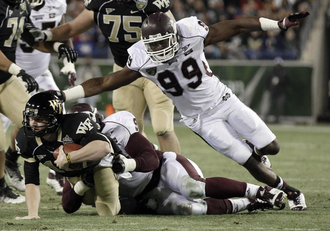Mississippi State defensive lineman Sean Ferguson (99) helps defensive lineman Fletcher Cox, center, bring down Wake Forest quarterback Tanner Price, left, in the second quarter of the Music City Bowl NCAA college football game on Friday, Dec. 30, 2011, in Nashville, Tenn. (AP Photo/Mark Humphrey)