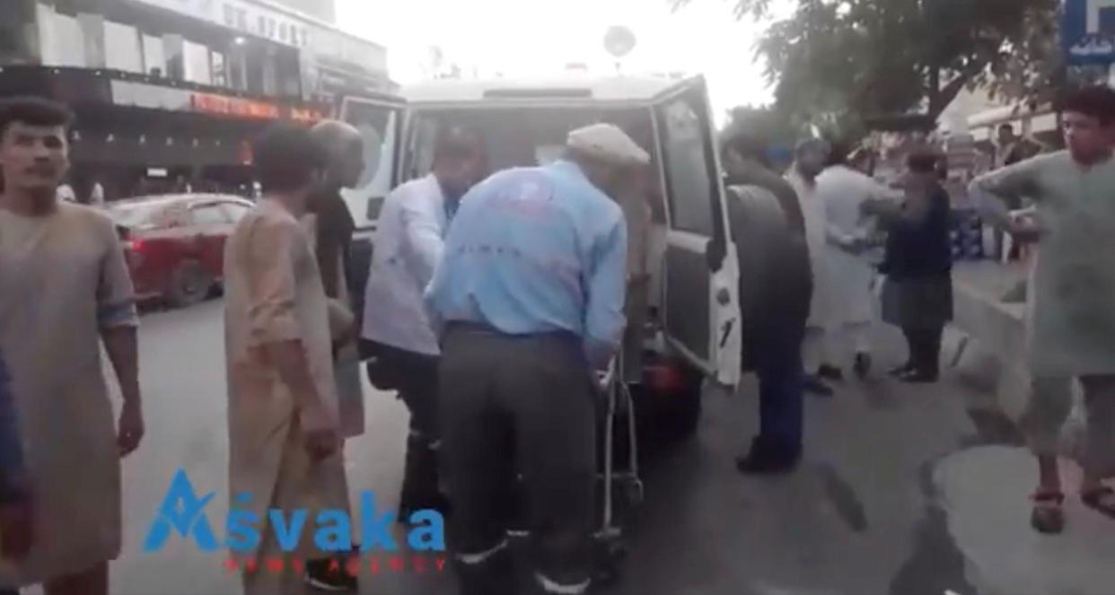Injured people being helped out of an ambulance in Kabul. (Asvaka via Reuters)