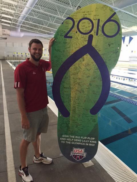 Aaron Opell poses next to a flip-flop at the pool in Lilly King's hometown. (Yahoo Sports)
