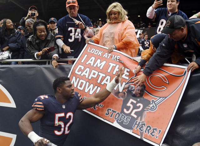 FILE - In this Sunday, Sept. 30, 2018, file photo, Chicago Bears linebacker Khalil Mack (52) celebrates with fans after the Bears defeated the Tampa Bay Buccaneers 48-10 in an NFL football game in Chicago. The Bears rolled into their bye week with their most lopsided victory in six seasons and sole possession of the NFC North lead for the first time in five years. For a team long buried at the bottom of the division, its a different look. (AP Photo/David Banks, File)