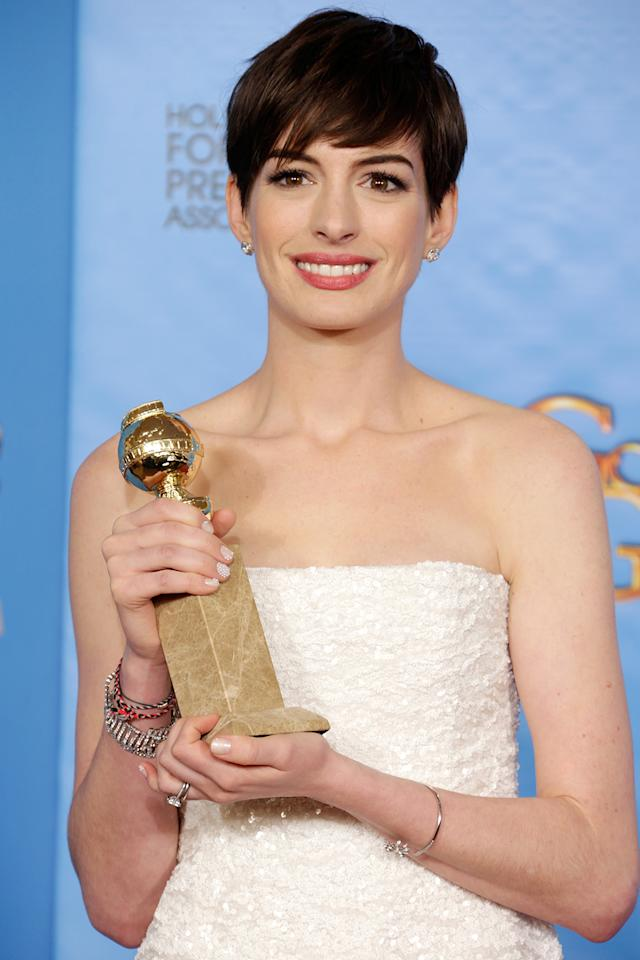 Anne Hathaway poses in the press room at the 70th Annual Golden Globe Awards held at The Beverly Hilton Hotel on January 13, 2013 in Beverly Hills, California.
