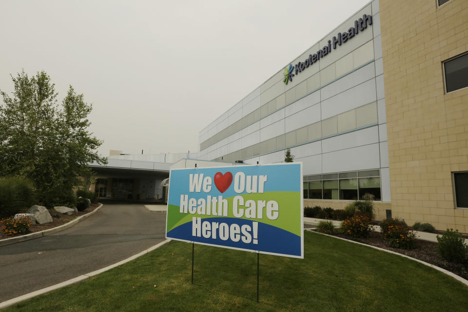 A sign supporting healthcare workers is photographed at Kootenai Health, Friday, Sept. 10, 2021, in Coeur d'Alene, Idaho. Northern Idaho has a long and deep streak of antigovernment activism that is confounding attempts to battle a COVID-19 outbreak.(AP Photo/Young Kwak)