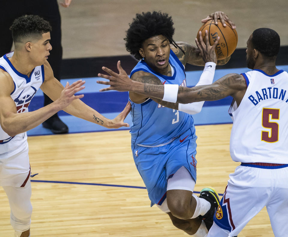 Houston Rockets guard Kevin Porter Jr. (3) drives against the Denver Nuggets during the third quarter of an NBA basketball game Friday, April 16, 2021, in Houston. (Mark Mulligan/Houston Chronicle via AP)