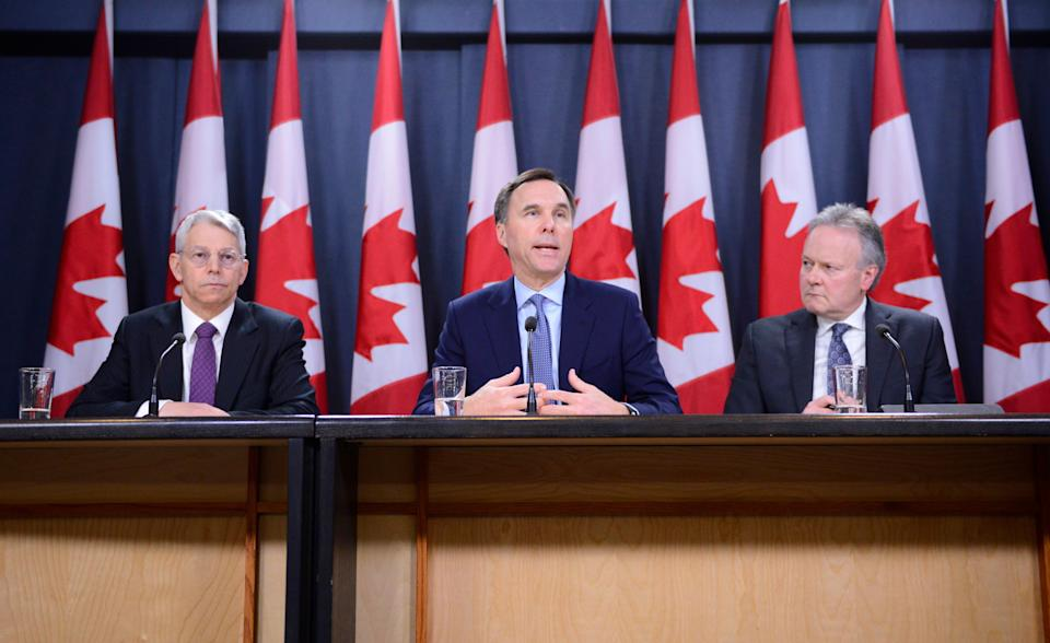 Superintendent of Financial Institutions Jeremy Rudin, left to right, Finance Minister Bill Morneau, and Bank of Canada Governor Stephen Poloz take part in a press conference at the National Press Theatre in Ottawa on March 13, 2020. (Photo: Sean Kilpatrick/CP)