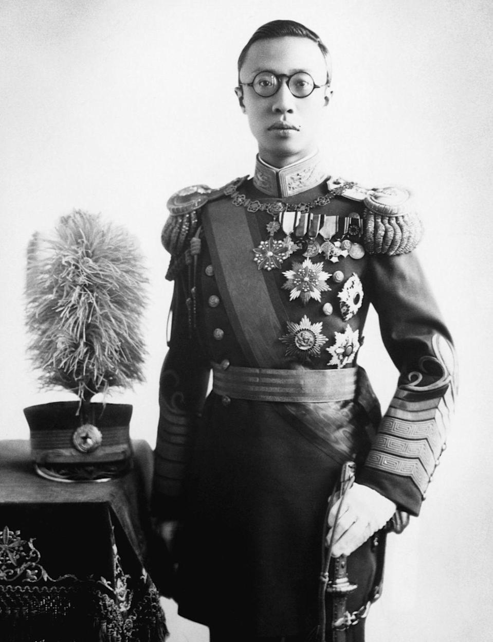 """<p>Puyi, the Last Emperor of China, married Empress Wanrong """"on December 1, 1922, the date and time having been chosen by imperial astronomers,"""" per <a href=""""https://www.history.com/news/royal-weddings-gone-bad"""" rel=""""nofollow noopener"""" target=""""_blank"""" data-ylk=""""slk:History"""" class=""""link rapid-noclick-resp""""><em>History</em></a>. The publication cited several sources suggested that Puyi, """"overwhelmed by the long night's merrymaking and distracted by the red decorations adorning the bed, panicked and fled the scene."""" Perhaps not the best indicator of marital bliss.</p>"""