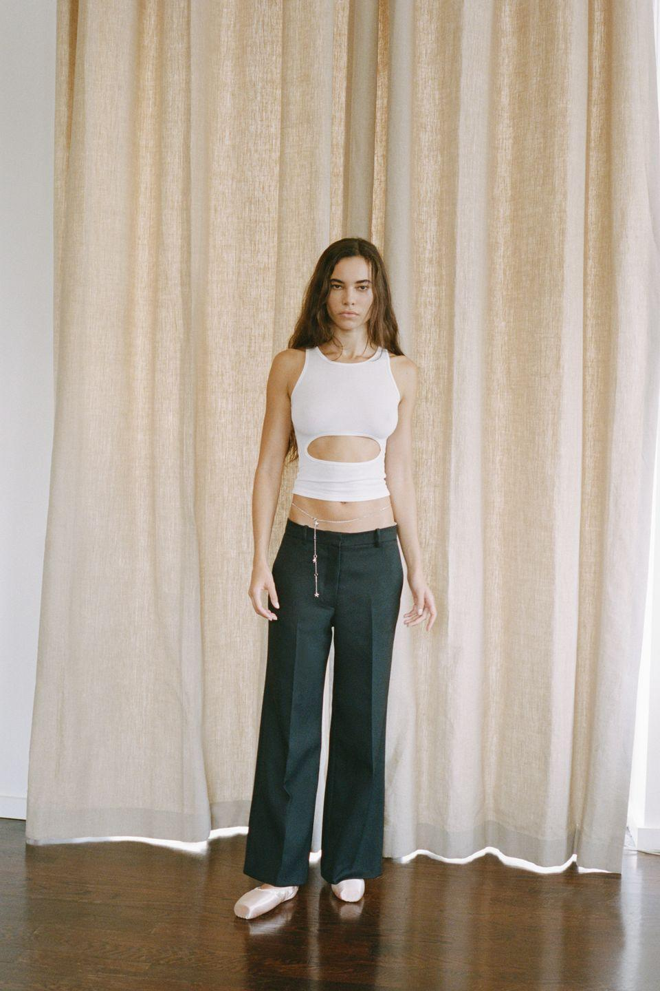 """<p>Sandy Liang often finds inspiration from nostalgia, looking back to look forward—but not too far back in time. The designer tends to look toward her youth for inspiration, but for Spring 2021, she focused on her current mood as much as her obsessions from the past. While many of the collections this season stood to be stifled by the pandemic pause, Liang noted that this time, she had """"more time to breathe, to think and draw freely."""" That freedom resulted in separates we'd all want to wear during and post lockdown, as well as a cheeky """"Margot print"""" that graced dresses, tops, and skirts—designed in collaboration with Rabin. The print is an ode to Liang's forever inspiration Margot Tenenbaum and Ponyo (a Japanese cartoon), and sat well with the micro mini skirts, gingham, and a fleece jacket with Lisa Frank-esque blooms down the sleeves. Other notes on nostalgia the designer embraced included super low-rise bottoms, cheerleader-style tennis skirts, and pieces that riffed on the standard crop top. <em>—Carrie Goldberg</em></p>"""