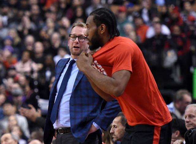Feb 11, 2019; Toronto, Ontario, CAN; Toronto Raptors head coach Nick Nurse speaks to forward Kawhi Leonard (2) as he prepares to enter the game against Brooklyn Nets in the second half at Scotiabank Arena. Mandatory Credit: Dan Hamilton-USA TODAY Sports