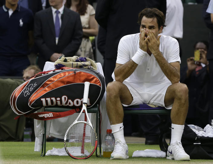 Roger Federer of Switzerland reacts after winning the men's singles final against Andy Murray of Britain at the All England Lawn Tennis Championships at Wimbledon, England, Sunday, July 8, 2012. (AP Photo/Kirsty Wigglesworth)
