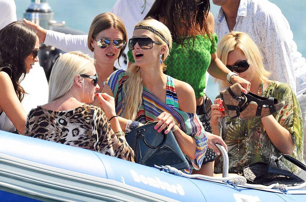 """Hotel heiresses Nicky and Paris Hilton have traveled all over this July, including a stop in St. Tropez, where they took a ride on a private luxury yacht. A/<a href=""""http://www.x17online.com"""" target=""""new"""">X17 Online</a> - July 22, 2010"""