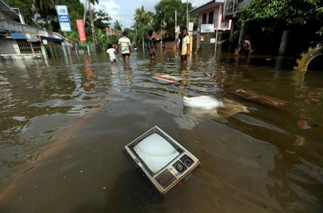 <p>A TV set floats on a flooded road in Dodangoda village in Kalutara, Sri Lanka, May 28, 2017. (Dinuka Liyanawatte/Reuters) </p>