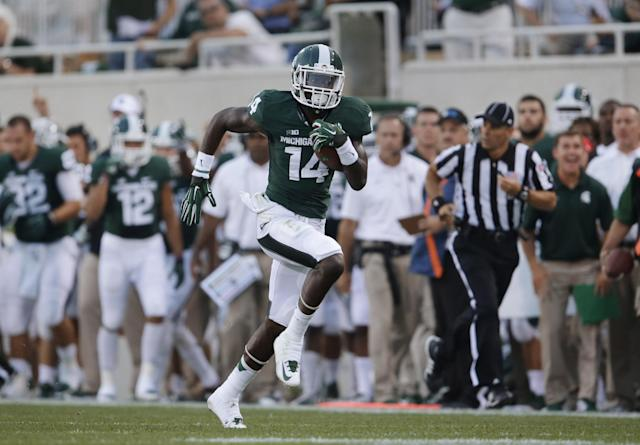 Michigan State wide receiver Tony Lippett scores on a 64-yard touchdown reception against Jacksonville State in the first quarter of an NCAA college football game in East Lansing, Mich., Friday, Aug. 29, 2014. (AP Photo/Paul Sancya)