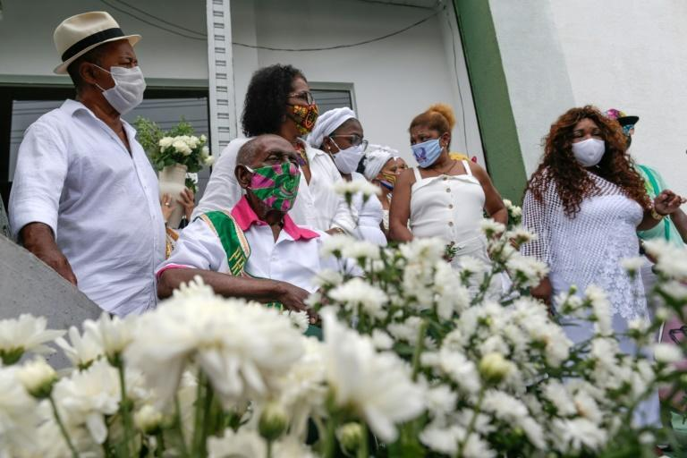 Members of Rio's samba schools are seen paying tribute on February 12, 2021 to victims of the coronavirus pandemic