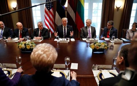 Donald Trump sits across from Lithuanian President Dalia Grybauskaite, Estonian President Kersti Kaljulaid, and Latvian President Raimonds Vejonis at a meeting on Tuesday - Credit: Kevin Lamarque/Reuters