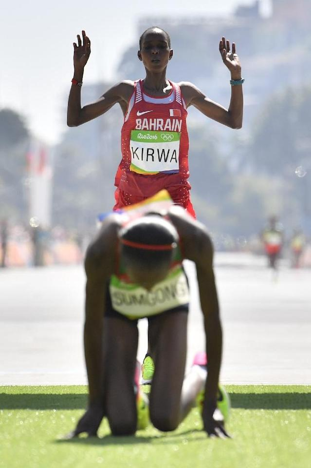 Bahrain's Eunice Jepkirui Kirwa celebrates her second place behind first placed Jemima Sumgong of Kenya in the women's Olympic marathon in Rio on August 14, 2016 (AFP Photo/Fabrice Coffrini)
