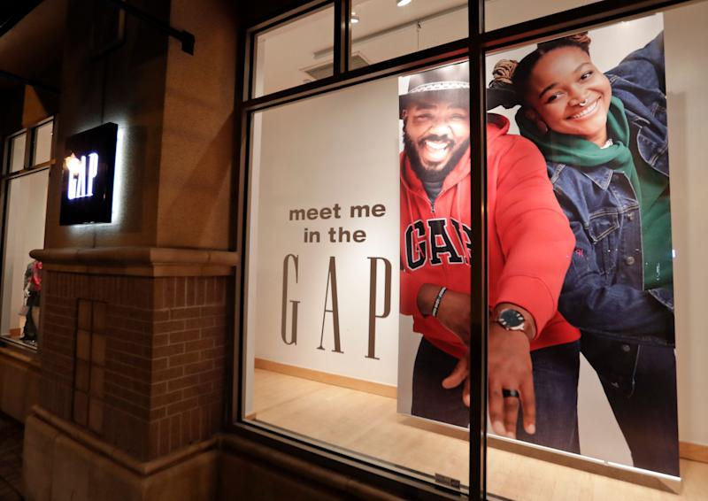 A window display at a Gap clothing store is seen Thursday, Aug. 23, 2018, in Winter Park, Fla. (AP Photo/John Raoux)